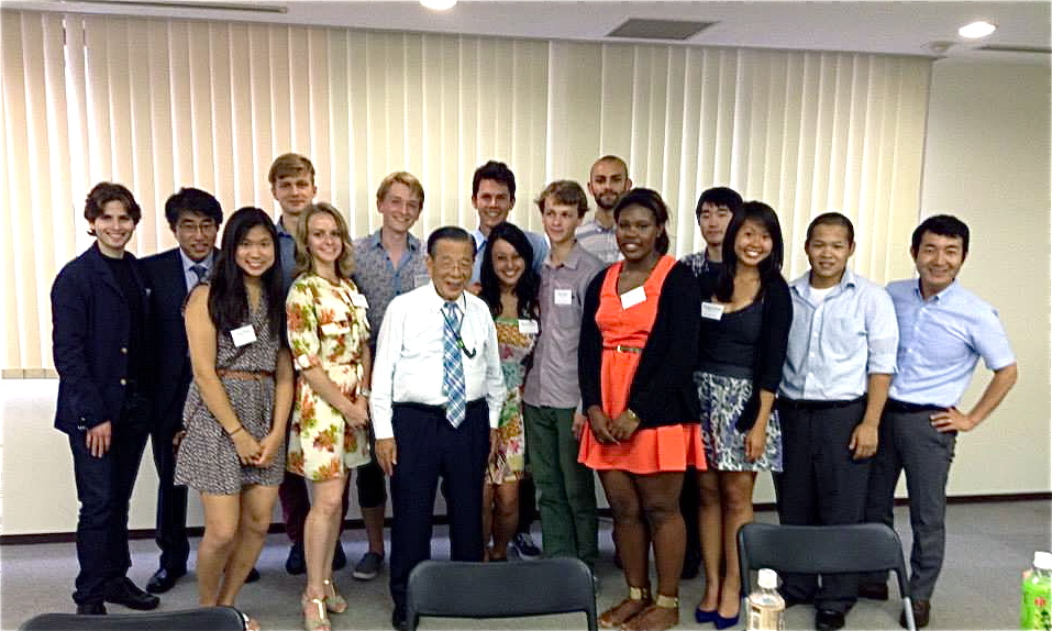 Elisa Edmondson (red dress) and other interns are pictured with Yoshiomi Tami, the founder of Ashinaga.